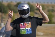 photo of Mr Hurst in motorcycle helmet and special T-shirt